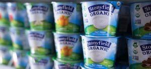 stonyfield yogurt cups on a grocery shelf